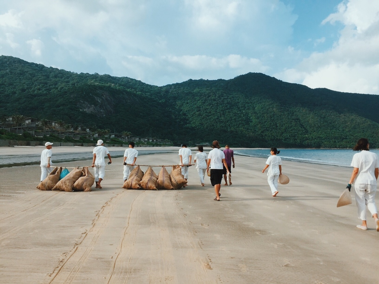 Six Senses Con Dao staff cleaning up the beach